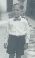 Photo of adorable four year old Shaun Eli in short pants suit and bow tie